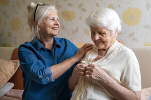 caregiver assisting senior with middle stage Alzheimer's